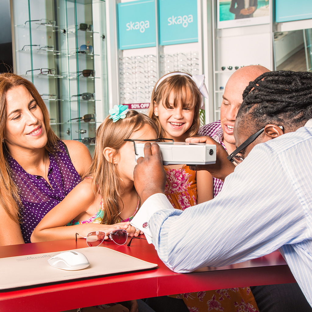 Boca Raton Optometrist with Patients Filling Patient Forms On Eye Care
